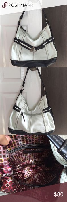 Tignanello leather handbag black/off white Tignanello leather handbag in an off white and black! Not sure it was ever carried! Looks new! Just cleaning out! Very comfortable one shoulder strap! Front slip pocket and back zipper pocket! One interior zipper pocket and one big slip pocket! Smoke free home! Gorgeous inside and out! Tignanello Bags Shoulder Bags