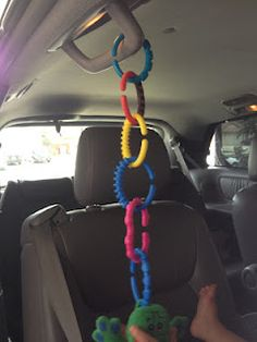 Use locking rings to hang a toy in the car for babies in regular car seats