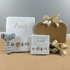 This cute safari design personalised baby bath towel set will make the perfect baby boy gift. This personalised towel baby gift arrives in it's own suitcase along with a cute little knitted elephant baby rattle. Monogram Towels, Personalized Towels, Personalised Baby, Bath Towel Sets, Bath Towels, Baby Boy Gifts, Baby Shower Gifts, Baby Hamper, Baby Rattle