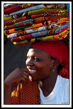 Africa | Fabric Seller.. | © Laurent Rappa