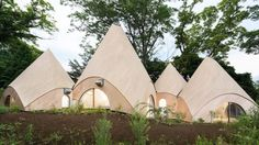 This enchanting cluster of teepee-like structures located in the mountains of Japan's Shizuoka Prefecture functions as a facility for two women in their sixties who operate a food delivery service for the elderly and a rehabilitation center for people with disabilities.