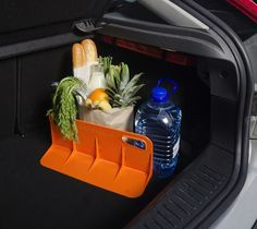 It is a solid plastic product that grips the carpet in your car and acts as a barrier to hold loose items securely against the side wall in your car trunk or boot.