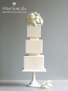 White square-tired wedding cake by Mon Cheri