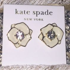New Kate Spade N York white cream flower earrings Brand new with tags. Kate Spade New York. Cream flower earrings with gorgeous rhinestone studs in the middle. 14k gold filled. Authentic. Comes with Kate Spade dust bag. kate spade Jewelry Earrings