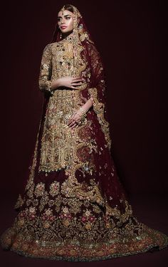 This bridal lehenga is featured in gold brocade shirt with zari hand embroidery all over it. Lehenga skirt is in maroon colour with heavily embroidered in zardo Pakistani Wedding Outfits, Bridal Lehenga Choli, Pakistani Wedding Dresses, Indian Dresses, Wedding Hijab, Indian Outfits, Fall Wedding, Latest Bridal Dresses, Bridal Outfits