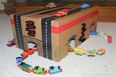 Turn a cardboard box into a playset full of train tunnels, roads and caves!