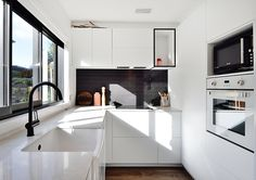 Niki & Tiff Kitchen from The Block NZ featuring Boston Lavagna 75 x 300mm from Tile Space.