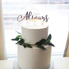 """This wedding cake topper simply states """"Always"""" for an utterly romantic dessert table statement. This cake topper is available in gold mirror as pictured, natural wood for a vintage type feel, or a va"""