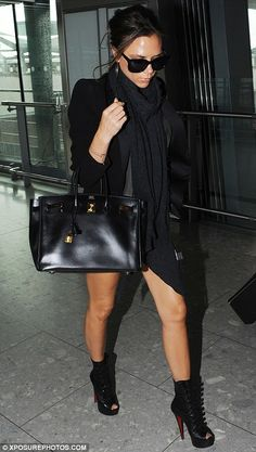 Shaken but stylish: Victoria arrives back in London after her LA-bound flight was forced to head back to Heathrow - but she managed a quick outfit change before landing