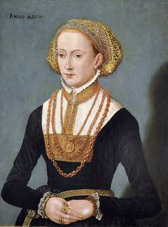 """The head dress looks to me to be the precursor of the later flitterhaube.  To be completely honest, I'm not sure whether this lady best exemplifies general """"Bavarian"""" or """"Nurnberg"""" - so I'll err on the side of calling her just Bavarian. Her dress is clearly a later style, with close-cut sleeves and a goldworked brustfleck that will come to typify the style as we get into the later decades of the 16th century"""