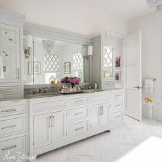 Pale Gray Bath Vanity Cabinets with White Marble Herringbone Tile Floor