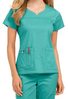 by Med Couture Lexi notch neck scrub top Scrubs Outfit, Scrubs Uniform, Scrub Suit Design, Med Couture Scrubs, Scrubs Pattern, Stylish Scrubs, Medical Scrubs, Nurse Scrubs, Womens Scrubs