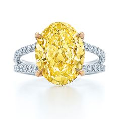 This fancy yellow oval diamond ring by Kwiat is set in platinum and 18k yellow gold.