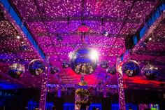 A huge inventory of mirror balls with six different sizes in Got Light's Mirror Collection keeps the parties thumping all night long. Photo by Show Ready Photography. Lighting Design by Got Light.
