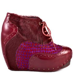 Add a pinch of Victorian mod to your next outfit in this quirky style from Irregular Choice. What An Angel has a vibrant red fur upper with lace up detail, croc print and leather. A 1 1/2 inch hidden platform and a 4 1/2 inch wedge gives you a surprise of height and a trendy look to your wardrobe.