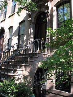 """Carrie Bradshaw's Front Stoop Carrie Bradshaw's front stoop features prominently in many scenes in """"Sex & The City."""" On the show, she is depicted as living on the Upper E..."""