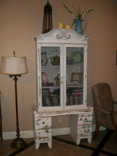 shelves made into a china cabinet, base is an old dresser bottom, top doors replace with screen so you can see through it.
