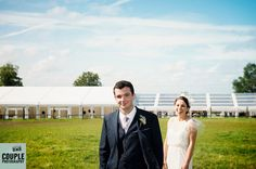The happy couple with the marquee in the background! Irish Marquee wedding photographed by Couple Photography.