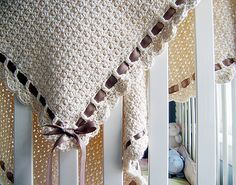 Crochet baby blanket with ribbon trim