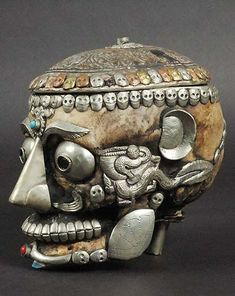 An impressing work from Tibetan craftsmen: a human skull decorated for ritual use.