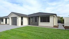 This home, built for the is designed to suit a range of people as they age. The homes in Upper Hutt, NZ, were created by the Dugdale Trust. Pocket Neighborhood, Pathways, Car Parking, The Neighbourhood, Trust, Shed, Range, Outdoor Structures, House Design