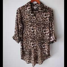 """Marisol animal print top Animal print top - collared style - front button closure - long roll up sleeves - polyester - semi-sheer - high low hemline - chest across measures 20"""" - total front length measures 21"""" - total back length measures 29"""" - size L Marisol Tops"""