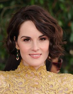 Michelle Dockery in Bulgari  To accessorize her gold Alexandre Vauthier dress, the actress and star of Downton Abbey decided on rose gold Bulgari earrings set with emeralds and diamonds.