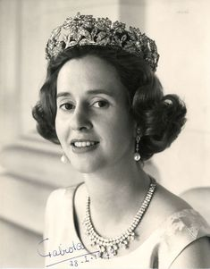 Queen Fabiola wears the wreath version of the Spanish Wedding Gift Tiara, the convertible Wolfers necklace/tiara, and her pearl drop earrings