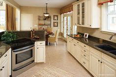This large kitchen is open to the breakfast and great room. Plan #984 - The Trotterville. http://www.dongardner.com/plan_details.aspx?pid=2664. #Kitchen #OpenConcept #Design