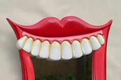 Smiling Mouth shaped wall mirror with large teeth by funkymirrors.