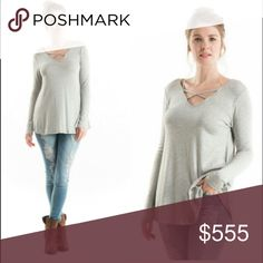🆕 ARRIVAL heather grey top Perfect light weight top to wear this fall with your favorite booties. Adorable cross cross pattern on front. Material include 96% rayon and 4% spandex. Perfect closet staple for this season. Additional pictures to come soon Fashionomics Tops Blouses