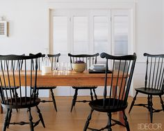 I like the dark/light contrast of black fanback chairs with a classic farmhouse table.