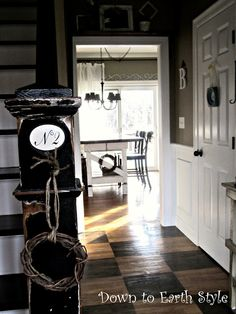 I like the earthy, modern, country deep neutral colour of the walls and the stenciled  check  wooden floorboards