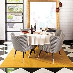 I love this room. Houndstooth chairs and a gold framed white board.