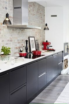 Black Kitchen Inspiration...black cabinetry in combination with the brick wall (and a dash of red)...beautiful!
