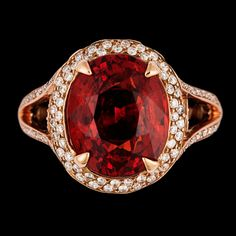 A spessartite garnet, 10.55 cts, and brilliant cut diamond ring, tot 0.71 ct.  18k pink gold