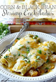 Corn tortillas stuffed with shrimp, corn, and black beans, drenched in delicious salsa verde, then smothered in bubbly cheese. Perfect shrimp enchiladas!