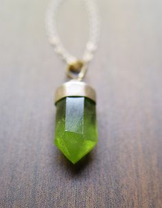 This natural peridot piece is as unique as it is beautiful.  Highlighting a beautiful natural glowing green peridot gemstone which was hand crafted