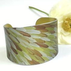 Emu Dreaming cuff in gold colours. Australian made bracelet with aboriginal art.