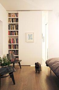 sliding door in front of bookshelves idea for living room?