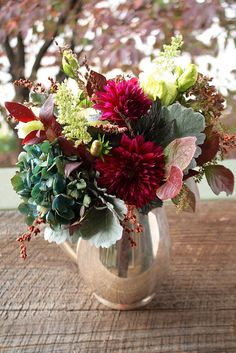 Lovely fall arrangement. Burgundy dahlias, antique green hydrangea, Lisianthus, lamb's ear, and naturals!