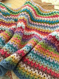 V-Stitch blanket -- Perfect for a scrap-ghan! Crochet Diagrams: Crochet V Stitch - Free Diagram V-Stitch blanket--Color Inspiration only, does not link to pattern Good morning ladies it's Friday at last enjoy your day by ella. V-Stitch blanket - This migh V Stitch Crochet, Knit Or Crochet, Crochet Crafts, Crochet Stitches, Crochet Hooks, Crochet Projects, Crotchet, Diy Projects, Diy Crafts