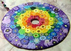 Many tiny polymer clay canes make up this disc of colors.