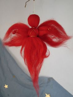 How to make a simple angel (don't care for the red at all...)  For those who don't know, roving is like yarn, only not twisted together.