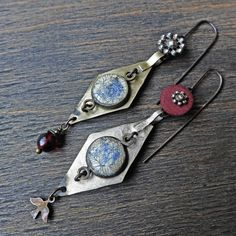 """Handmade artisan earrings with vintage Kuchi and buttons- """"Palingenesis"""" by fancifuldevices on Etsy https://www.etsy.com/listing/517458630/handmade-artisan-earrings-with-vintage"""