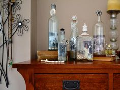Display your favorite photos in a decorative bottle adorned with seashells, beach sand and trinkets.