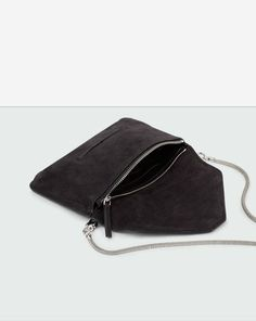 Small envelope clutch in seasonal leathers.