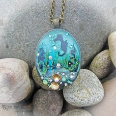 Rock Pool Oval Pendant ~~ seahorse necklace, marine life, coral, ocean inspired necklace, nature jewellery, diorama by BijouButDeadly on Etsy https://www.etsy.com/uk/listing/228136078/rock-pool-oval-pendant-seahorse-necklace