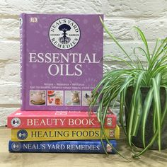 Neal's Yard Remedies book collection: Essential Oils, Beauty Book, Healing Foods, and Cook, Brew, and Blend Your Own Herbs giving us wellbeing bookshelf goals all day long.