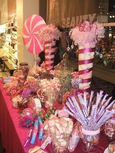 Yum!  Cute pink and purple candy buffet Quinceanear.  Shop all sizes of affordable glass vases at afloral.com. #cutequince #candybuffet #afloral photo credit: tiarasandtacones.com
